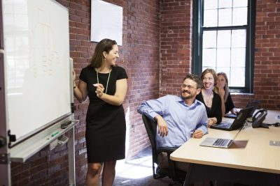 Woman presenting in front of meeting room